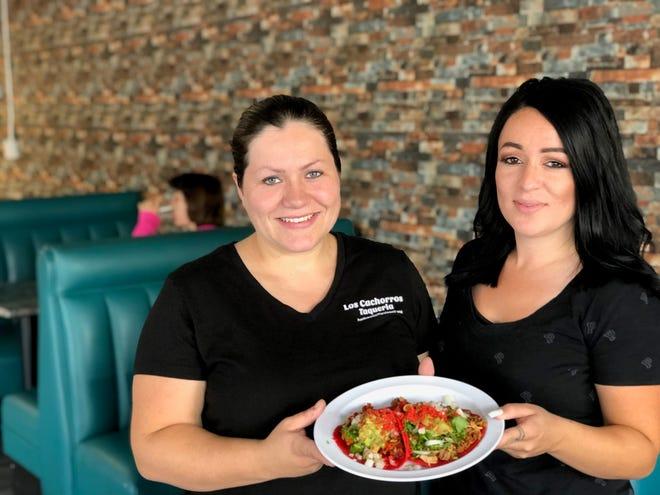 Fabiola Muñoz-Torres, left, and her sister Jessica Muñoz at the new Los Cachorros Taqueria on Athens Avenue in Redding.
