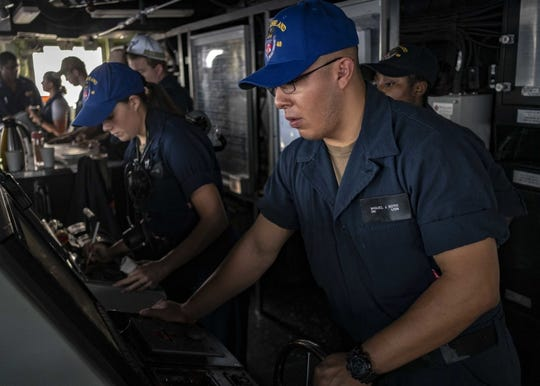Seaman Miguel Soto, right, from San Angelo, and Seaman Sydney Aust, from Lawton, Oklahoma, stand watch on the bridge aboard the amphibious dock landing ship USS Ashland (LSD 48). Ashland, part of the Wasp Amphibious Ready Group, with embarked 31st Marine Expeditionary Unit, is operating in the Indo-Pacific region to enhance inter-operability with partners and serve as a ready-response force for any type of contingency.