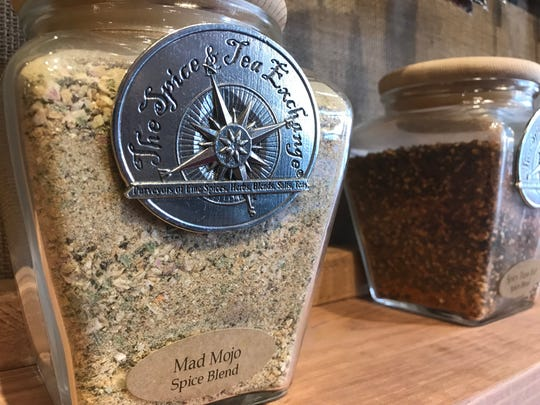 Spices rest on the shelves of The Spice & Tea Exchange in downtown Sioux Falls. The store is hosting a grand opening event this weekend.