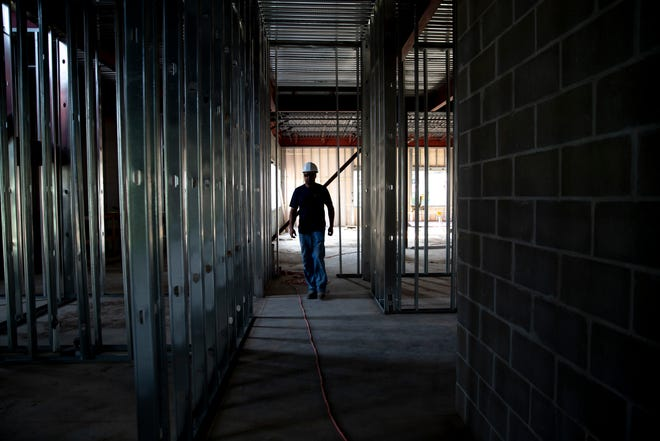 A construction worker in Brookings, SD, Friday, Aug. 9.