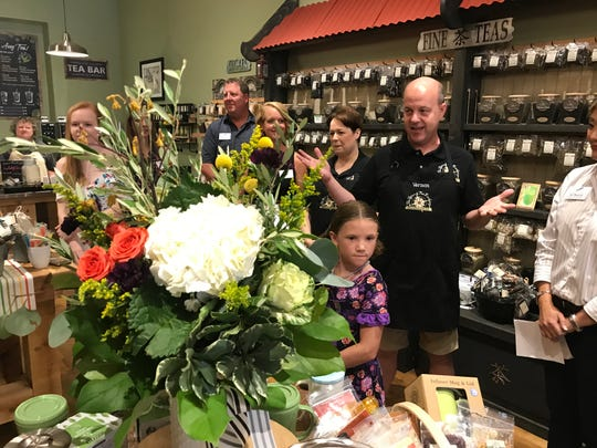 The Spice & Tea Exchange franchise owners Tami (middle right) and Vernon Brown (foreground) welcomed Sioux Falls business leaders and others to their store Friday for a ribbon-cutting event. The store is hosting a grand opening event this weekend.