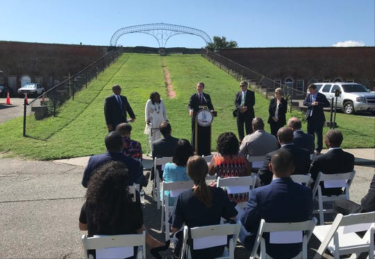 Virginia Governor Ralph Northam speaks to local dignitaries at Fort Monroe in Hampton in front of the arch that once bore Jefferson Davis name, on August 6, 2019.