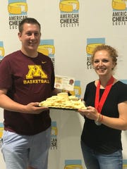 Lucas and Alise Sjostrom pose with a plate of their award-winning St. Anthony cheese at the American Cheese Society awards Aug. 2, 2019 in Richmond, Virginia.