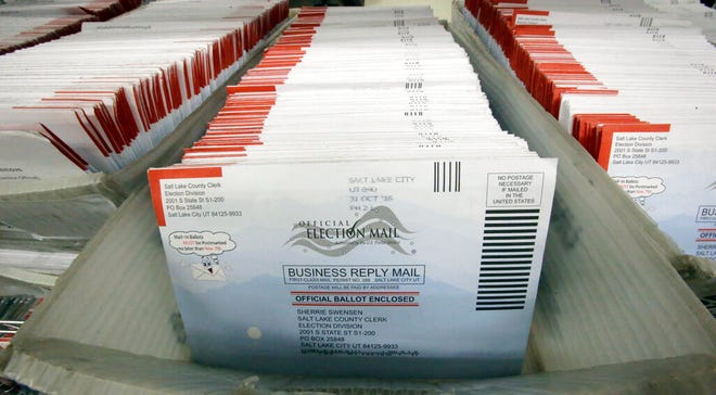 FILE - In this Nov. 1, 2016, file photo, mail-in ballots for the 2016 General Election are shown at the elections ballot center at the Salt Lake County Government Center, in Salt Lake City. Voter fraud is rare in the state and typically involves parents submitting ballots for children who are away from home serving missions for The Church of Jesus Christ of Latter-day Saints, the state's lieutenant governor said. Lt. Gov. Spencer Cox said voter fraud is usually the result of a misunderstanding of election laws, The Salt Lake Tribune reported Thursday, Aug. 8, 2019. (AP Photo/Rick Bowmer, File)