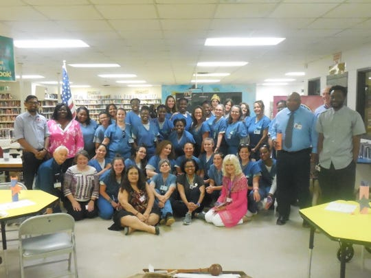 Driven by Destiny Toastmasters Club: members, Gadsden staff, and volunteers/mentors celebrate together.
