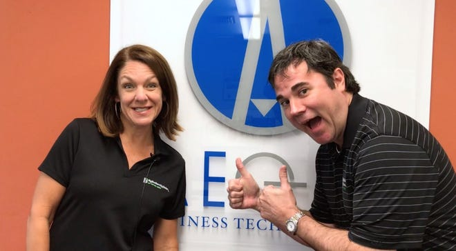 Big Brothers Big Sisters CEO Alva Striplin with Aegis Business Technologies CEO Blake Dowling teamed up for a promotion.
