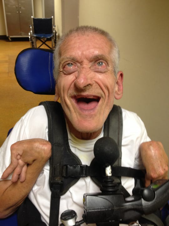 Loren Miner, shown in a moment of joy, died Aug. 1 at age 71.