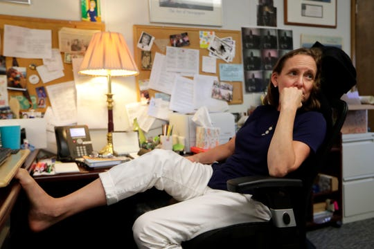 News Director of the Tallahassee Democrat Jennifer Portman ponders the latest news at her desk Friday, Aug. 9, 2019.