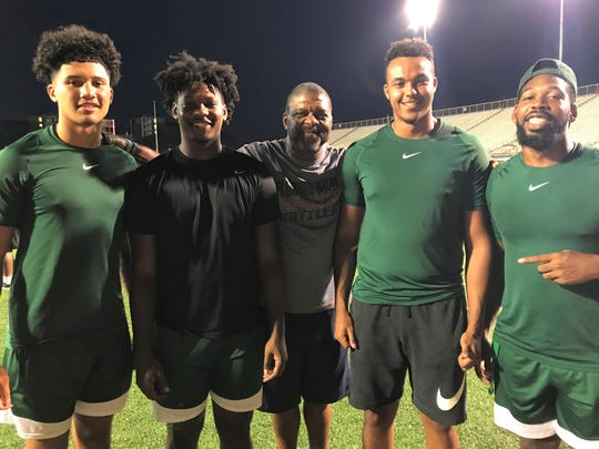 FAMU tight ends Kaloeb Parker (left), Kamari Young, Kieran Goodrich and Marquan Cromartie are looking to make an impact in the offense. Position coach James Spady (center) is pleased with their progress through camp.