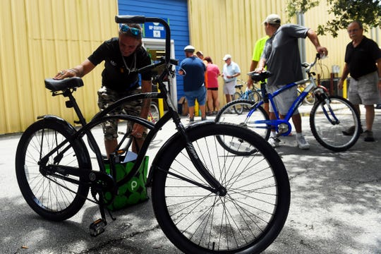 "Mark Smith inspects his newly refurbished bicycle he received after finishing a safety program at the United Against Poverty building on Wednesday, Aug. 7, 2019, in Vero Beach. Smith, currently homeless, said his previous bike was stolen which he used everyday to find work. ""This is such a great program,"" Smith said, ""and I'm so thankful to the people who run it."" The bike distribution is run in conjunction with United Against Poverty and Bike Walk Indian River County."