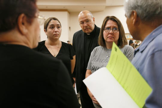 "The Rev. Pablo Matta, center, checks in on each group that attended ""Standing Against Fear,"" hosted by EPISO/Border Interfaith, on Thursday, Aug. 8, at St. Paul's Catholic Church in El Paso. Attendees were asked to gather in groups of five and ask each other, ""How are you feeling?"" and ""How are you doing?"""