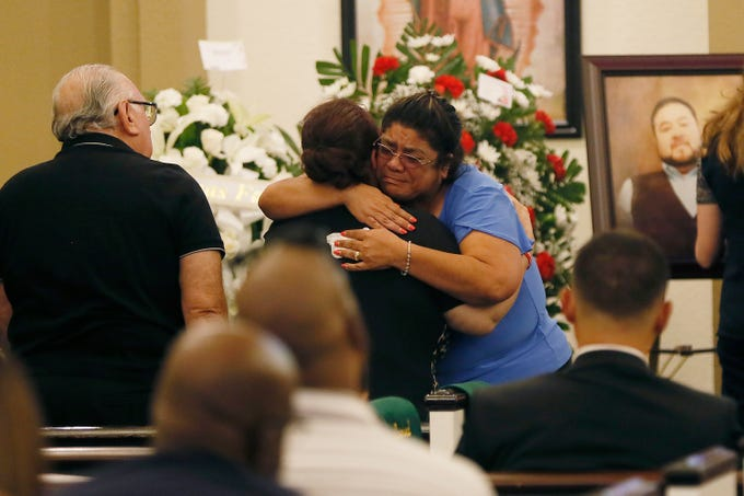 Friends and family attend a service for Leonardo Campos on Thursday, Aug. 8, at Sunset Funeral Home in El Paso. Campos was one of 22 people killed in the shooting at Walmart on Aug. 3.