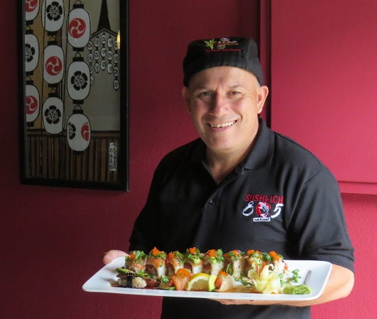 Alberto Vazquez, chef and owner of Sushi-Ichi 805 in Port Hueneme, poses with the Nava roll and other selections.