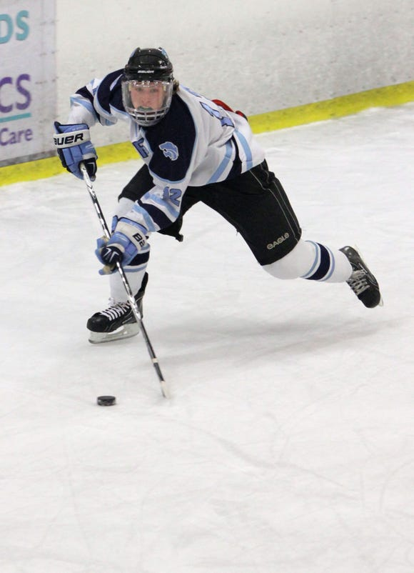 Suffern's John Redgate skates down the ice with the puck in the first period during the ice-hockey game at Sport-O-Rama in Monsey on Dec. 16, 2011.