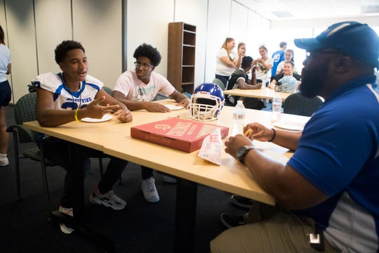 Football players and coaches take part in The News Journal's High School Football Media Day Friday, August 9, 2019 at The News Journal offices.