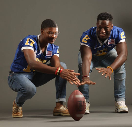 (left to right)Caesar Rodney High School football players Corey Handy and teammate Emmanuel Kennedy pose for a portrait at The News Journal's media day hosted at Dover High School.