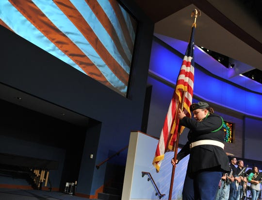 A Wichita Falls ISD color guard student places the flag during the annual teacher's pep rally held at the First Baptist Church downtown campus, Friday morning.