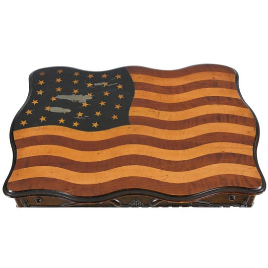 This unusual, flag-topped table is handmade but not unique. Another almost identical table sold at an auction years ago. It had only 23 stars. This table has 35. Could there be others?