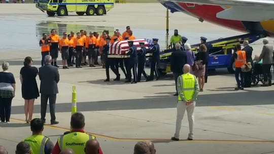Airline pilot flies dad's remains home from Vietnam 52 years after seeing him off at same Dallas airport