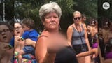 A woman was filmed flipping off and cursing at a Muslim American woman at Sesame Place in Pennsylvania.