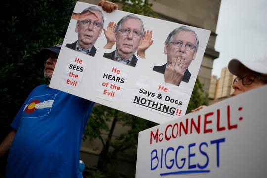 In reaction to the mass shootings in El Paso, Texas, and Dayton, Ohio, protesters convened outside Senate Majority Leader Mitch McConnell's (R-Ky.) office on August 6, 2019 in Louisville, Ky.