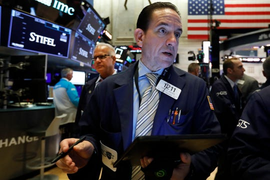 In this Aug. 6, 2019, file photo trader Tommy Kalikas works on the floor of the New York Stock Exchange. The U.S. stock market opens at 9:30 a.m. EDT on Friday, Aug. 9.