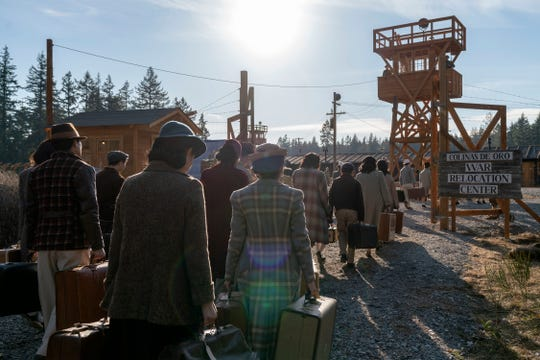 Japanese-Americans, down to only the possessions they can carry, enter a World War II internment camp in AMC's 'The Terror: Infamy.'