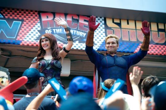 """Queen Maeve (Dominique McElligott) and Homelander (Anthony Starr) greet their adoring fans in subversive superhero show """"The Boys."""""""