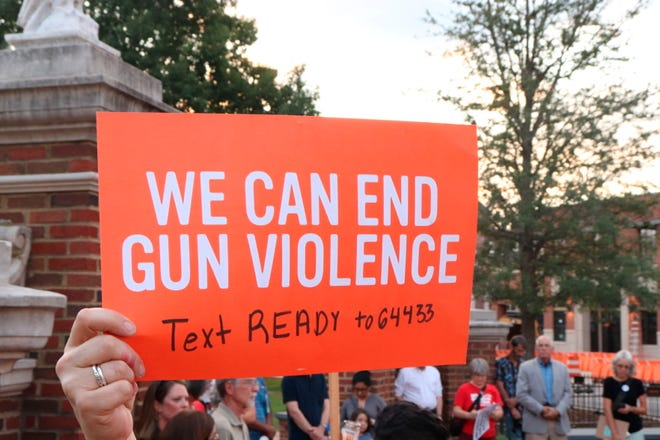 At a Moms Demand Action event, gun reform advocates protest against gun violence on Aug. 5, 2019 at Toomer's Corner Auburn, Ala.