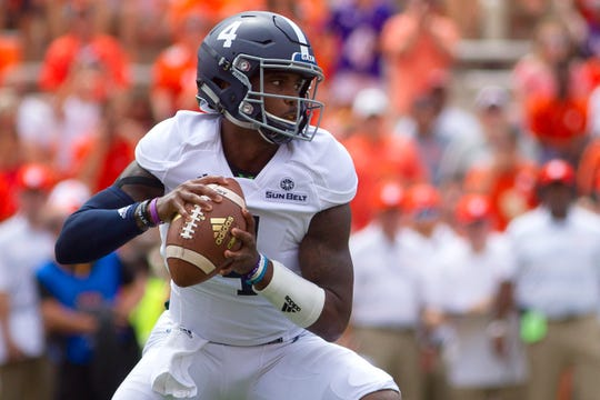 Georgia Southern Eagles quarterback Shai Werts (4) looks to pass the ball during the first quarter against the Clemson Tigers at Clemson Memorial Stadium.