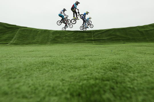 In this file photo, racers compete in the in the BMX Cycling Quarterfinal Race at the Lima 2019 Pan American Games at BMX Circuit of Costa Verde San Miguel in Lima, Peru.