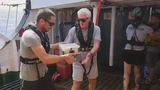 Richard Gere visited rescued migrants carrying boxes of fruit and other donations to Open Arms.