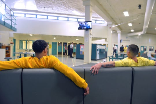 In this July 9, 2019 photo, clients watch TV at the Stonybrook Stabilization and Treatment Center at the Hampden County Correctional Center in Ludlow, Mass.