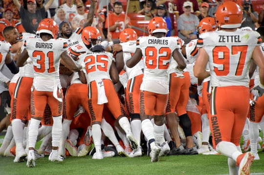 The Browns celebrate on the field after Damon Sheehy-Guiseppi returned a punt 86 yards for a touchdown.