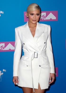 She opted for a belted, white Tom Ford dress at the 2018 MTV Video Music Awards in New York.