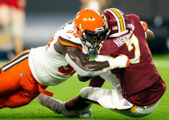 Browns defensive tackle Devaroe Lawrence sacks Redskins quarterback Dwayne Haskins.