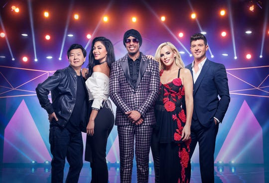 'The Masked Singer' host Nick Cannon, center, is joined by judges Ken Jeong, left, Nicole Scherzinger, Jenny McCarthy and Robin Thicke. All return for Season 2 of the Fox celebrity singing competition, which premieres Sept. 25.