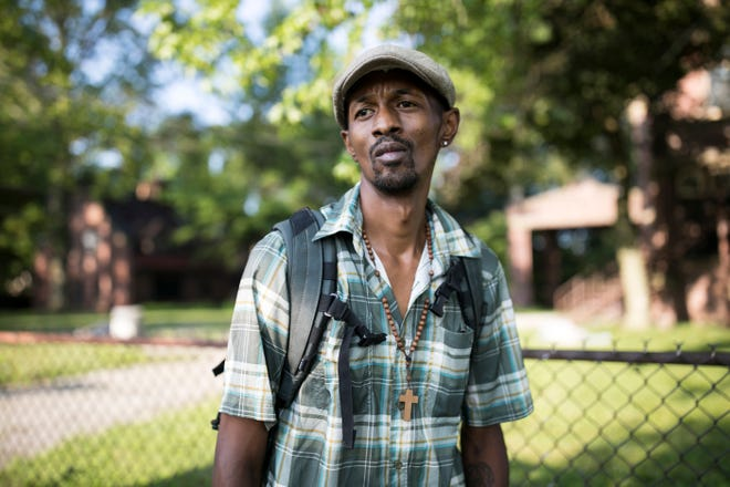 Trenton Burrell, who was diagnosed with hepatitis A, stands in Akron, Ohio, on July 23, 2019. Burrell, who used to live in a tent but now stays at a friend's house, believes he contracted the virus cleaning up trash left by fellow drug users without wearing gloves. Burrell now warns others to be careful of the dangers of touching dirty needles or other trash, and he spreads the word about vaccination. (Maddie McGarvey for KHN)