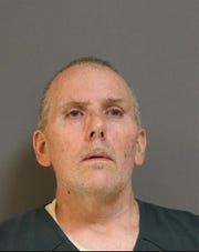 Booking photo from Saturday of Christopher J. Mallon, 49, of Manchester.