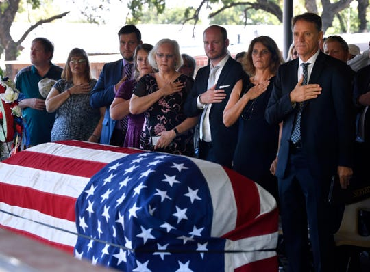 Family members of Col. Roy Knight Jr. stand as the National Anthem is played during Knight's memorial service Saturday in Cool, just outside of Mineral Wells August 10, 2019. Knight was shot down over Laos in 1967 while serving as a U.S. Air Force pilot in the Vietnam War. In February, Knight's remains were recovered and identified, then flown home last week for burial at Holders Chapel United Methodist Church.