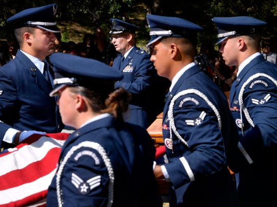 U.S. Air Force chaplain Maj. John Rollyson from Dyess Air Force Base officiates during the graveside service of Col. Roy Knight Jr. in Cool, Texas, outside of Mineral Wells August 10, 2019.
