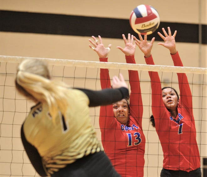 Cooper's Jennika Willis (13) and Diamond Brown (7) defend at the net as Abilene High's Gentri Anderson hits the ball. Cooper beat the Lady Eagles 25-15, 25-20 in the Gold Bracket consolation semifinals at the Bev Ball Classic on Saturday, Aug. 10, 2019, at AHS' auxiliary gym.