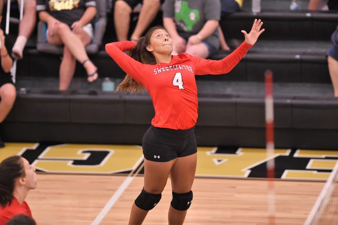 Sweetwater's Mia Valdez (4) goes up for a kill against Abilene High during pool play of the Bev Ball Classic at Eagle Gym on Friday, Aug. 8, 2019. The Lady Mustangs finished fourth in the Black Division.