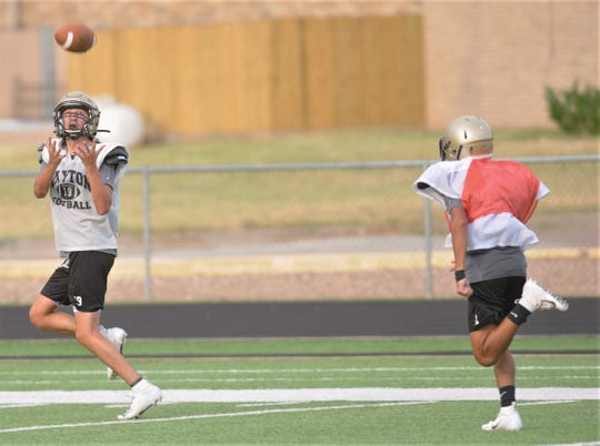 Jayton's Camron Benavides, right, hauls in a pass during practice Wednesday, Aug. 7, 2019, at Jaybird Stadium in Jayton. The Jaybirds are ranked No. 1 Dave Campbell's Texas Football magazine's Class 1A Division II preseason poll.