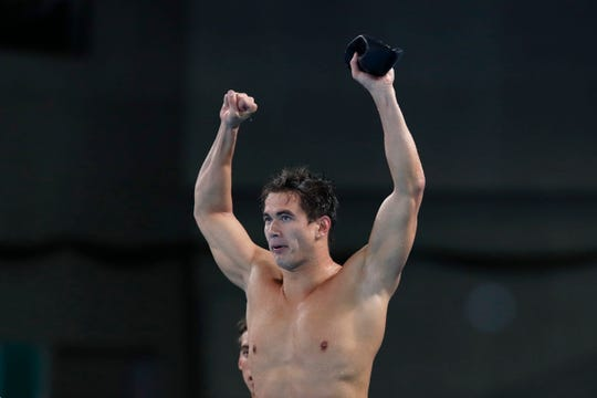 Nathan Adrian of the United States celebrates after his team won the gold medal in mixed 4x100m freestyle relay swimming at the Pan American Games in Lima, Peru, Wednesday, Aug. 7, 2019.