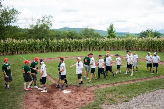 Teams shake hands at the conclusion of their game on the Field of Dreams field during the Travis Roy Foundation wiffle ball tournament at Little Fenway on Saturday afternoon August 10, 2019 in Essex, Vermont.
