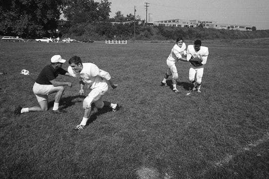 Players run a drill during practice prior to the start of the 1970 season.