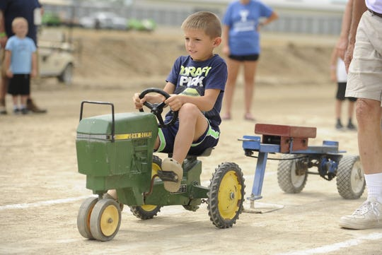 Owen Sykes of Clarksburg came out victorious in the second class of the kiddie tractor pull, pulling his weight 30 feet, and a-half-of-an-inch. Local kids competed at the 2019 Ross County Fair Kiddie Tractor Pull on Saturday Aug. 10 at the Ross County Fairgrounds in Chillicothe, Ohio.