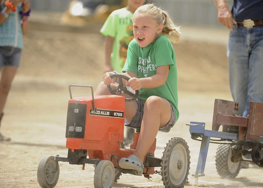 Josie Mallow, of Frankfort, won the fourth class in the kiddie tractor pull at the 2019 Ross County Fair, going 29 feet, 9 inches. Local kids competed at the 2019 Ross County Fair Kiddie Tractor Pull on Saturday Aug. 10 at the Ross County Fairgrounds in Chillicothe, Ohio.