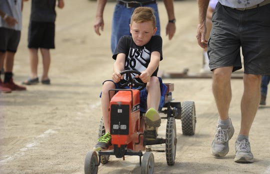 Davis Wireman of Chillicothe won the third class at the kiddie tractor pull, going 28 feet, seven-and-a-quarter-of-an-inch. Local kids competed at the 2019 Ross County Fair Kiddie Tractor Pull on Saturday Aug. 10 at the Ross County Fairgrounds in Chillicothe, Ohio.
